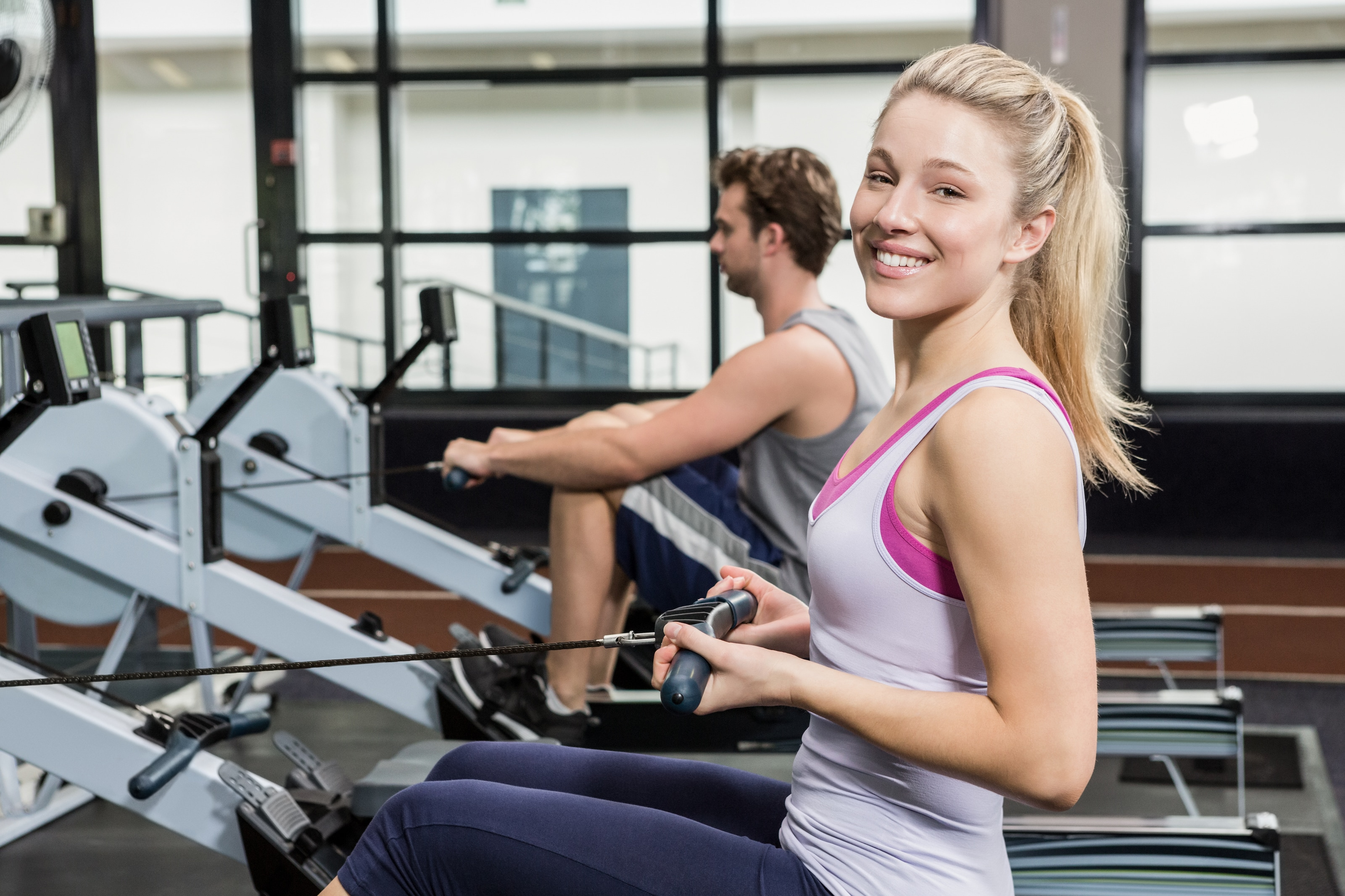 Woman exercising on an affordable rowing machine